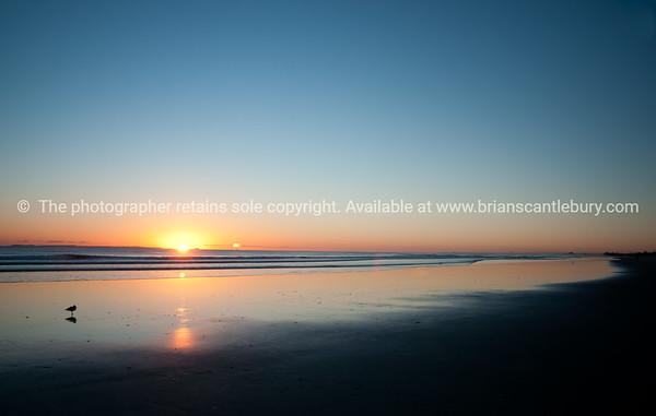 "Tauranga photo; beach as sun rises over horizon. See;  <a href=""http://www.blurb.com/b/3811392-tauranga"">http://www.blurb.com/b/3811392-tauranga</a> mount maunganui landscape photography, Tauranga Photos; Tauranga photos, Photos of Tauranga Also see; <a href=""http://www.brianscantlebury.com/Events"">http://www.brianscantlebury.com/Events</a>"