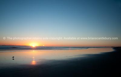 Tauranga photo; beach as sun rises over horizon. See; www.blurb.com/b/3811392-tauranga mount maunganui landscape photography, Tauranga Photos; Tauranga photos, Photos of Tauranga Also see; http://www.brianscantlebury.com/Events