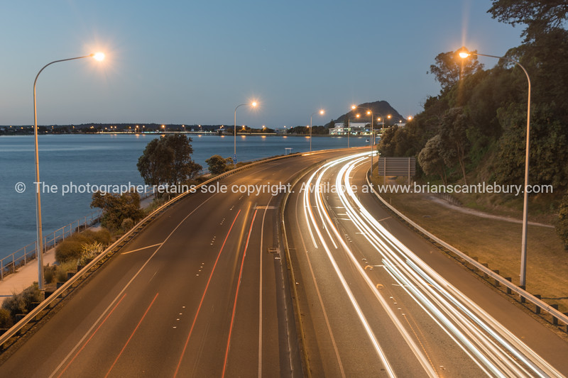 Tauranga New Zealand highway at night with vehicle light streaks