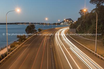 Tauranga New Zealand highway at night with vehicle light streaks