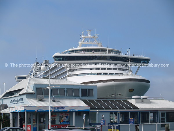 Cruise ship towers over Salisbury Wharf shop and restaurant.