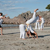 """Capoeira being practised on Mount Maunganui beach, Tauranga, New Zealand.<br /> Capoeira is a game, a sport, an art and a life philosophy, founded in Brasil in 1984. - 7<br /> Model Release; no. See;  <a href=""""http://www.blurb.com/b/3811392-tauranga"""">http://www.blurb.com/b/3811392-tauranga</a> mount maunganui landscape photography, Tauranga Photos; Tauranga photos, Photos of Tauranga Also see; <a href=""""http://www.brianscantlebury.com/Events"""">http://www.brianscantlebury.com/Events</a>"""
