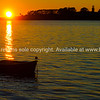 """Dinghy caught in golden rays of an autumn sunrise on Tauranga Harbour. See;  <a href=""""http://www.blurb.com/b/3811392-tauranga"""">http://www.blurb.com/b/3811392-tauranga</a> mount maunganui landscape photography, Tauranga Photos; Tauranga photos, Photos of Tauranga Also see; <a href=""""http://www.brianscantlebury.com/Events"""">http://www.brianscantlebury.com/Events</a>"""