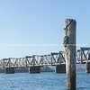 Tauranga harbour with steel railway bridge crossing