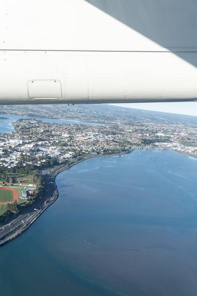 Tauranga harbour and urban peninsula aerial image with plane wing