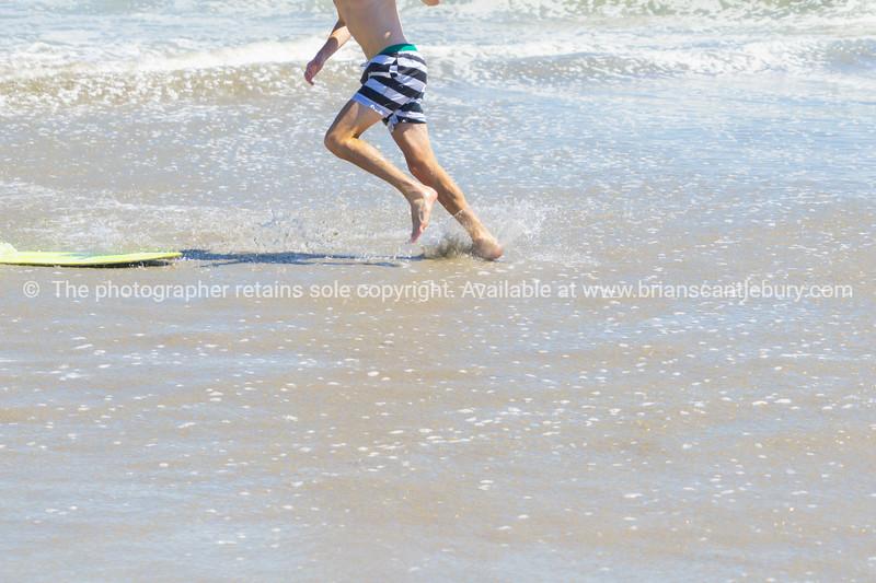 Skim-boarding in shallow water.