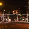 Tauranga's Devonport Road night scene with port cranes illuminated seemingly at end of road.