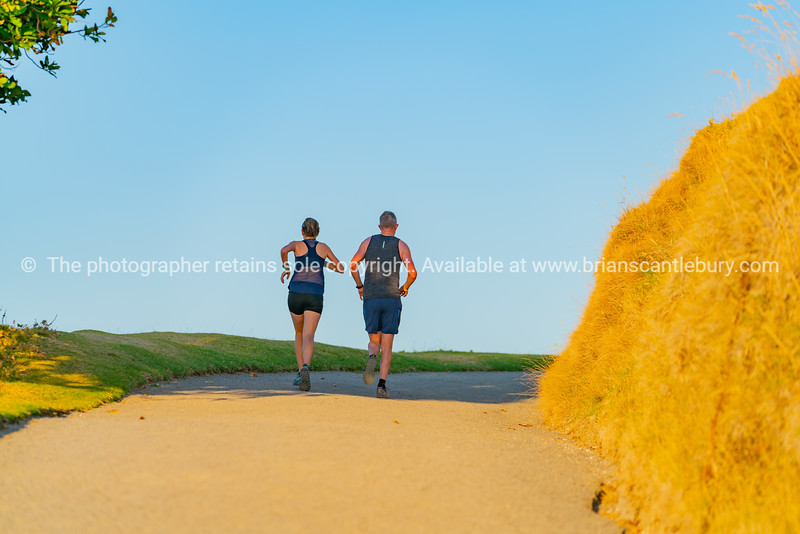 Couple out for morning run on track around Mount Maunganui.