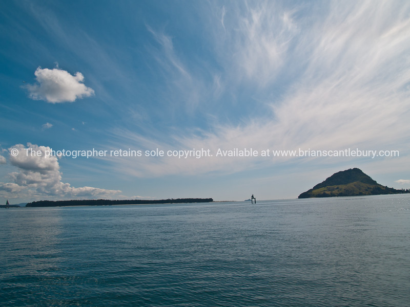 """Tauranga scenics. Mount maunganui and Tauranga Harbour, with ominous cloud indicatiing a change in the weather. See;  <a href=""""http://www.blurb.com/b/3811392-tauranga"""">http://www.blurb.com/b/3811392-tauranga</a> mount maunganui landscape photography, Tauranga Photos; Tauranga photos, Photos of Tauranga Also see; <a href=""""http://www.brianscantlebury.com/Events"""">http://www.brianscantlebury.com/Events</a>"""