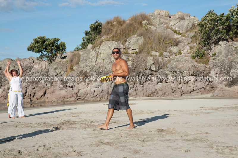 """Capoeira being practised on Mount Maunganui beach, Tauranga, New Zealand.<br /> Capoeira is a game, a sport, an art and a life philosophy, founded in Brasil in 1984. Tutor directs his students. -5<br /> Model Release; no. See;  <a href=""""http://www.blurb.com/b/3811392-tauranga"""">http://www.blurb.com/b/3811392-tauranga</a> mount maunganui landscape photography, Tauranga Photos; Tauranga photos, Photos of Tauranga Also see; <a href=""""http://www.brianscantlebury.com/Events"""">http://www.brianscantlebury.com/Events</a>"""