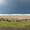 """Panoramic view of oceanbeach at Mount Maunganui as dark clouds fill the sky. New Zealand. Tauranga is New Zealands 5th largest city and offers a wonderfull variety of scenic and cultural experiences. Tauranga stock images Tauranga scenics. See;  <a href=""""http://www.blurb.com/b/3811392-tauranga"""">http://www.blurb.com/b/3811392-tauranga</a> mount maunganui landscape photography, Tauranga Photos; Tauranga photos, Photos of Tauranga Also see; <a href=""""http://www.brianscantlebury.com/Events"""">http://www.brianscantlebury.com/Events</a>"""