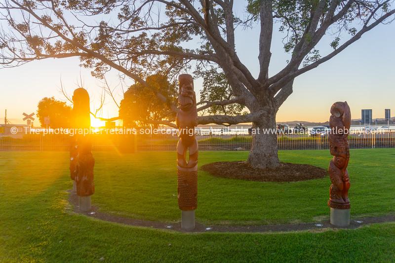 The Kahui Matariki maori carved totem poles in semi-circle