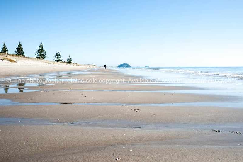 Papamoa Beach. People in distance along the long beach to Mount Maunganui.