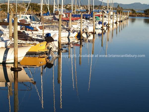 Reflections in calm of Tauranga Marina.
