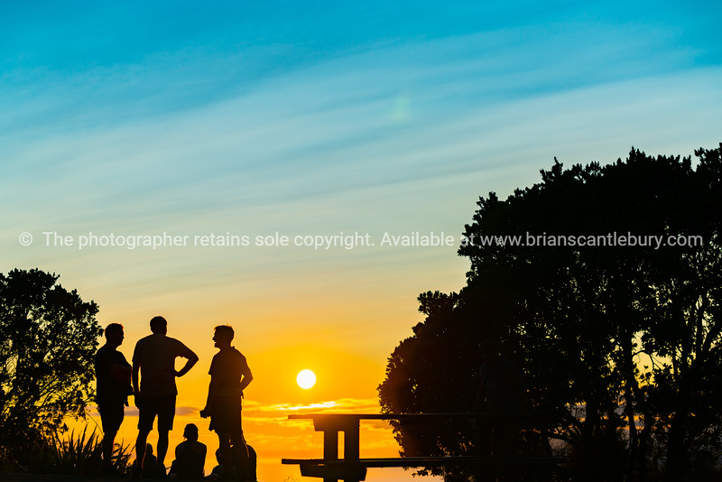 People up early and at top Mount Maunganui to catch beautiful sunrise.