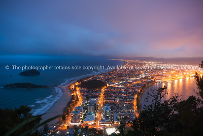 Mount Maunganui township lit by night lights from top of Mount Maunganui.