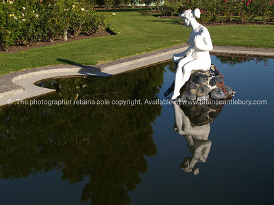 "Tauranga scenics.  White lady statue, reflected in public garden pond, ""Rose gardens"", Tauranga New Zealand. Tauranga is New Zealands 5th largest city and offers a wonderfull variety of scenic and cultural experiences. Tauranga stock images Tauranga scenics. See; www.blurb.com/b/3811392-tauranga mount maunganui landscape photography, Tauranga Photos; Tauranga photos, Photos of Tauranga Also see; http://www.brianscantlebury.com/Events"