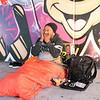 Homeless man by name of John early moring in his orange sleeping bag under tauranga Harbour Bridge