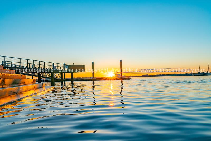 Sunrise over blue water of Tauranga harbour