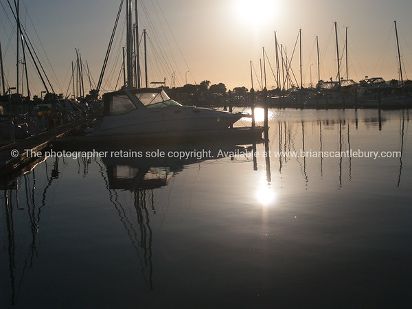 "Tauranga scenics.<br /> <br /> Marina boats backlit by morning sun. Tauranga is New Zealands 5th largest city and offers a wonderfull variety of scenic and cultural experiences. Tauranga stock images Tauranga scenics. See;  <a href=""http://www.blurb.com/b/3811392-tauranga"">http://www.blurb.com/b/3811392-tauranga</a> mount maunganui landscape photography, Tauranga Photos; Tauranga photos, Photos of Tauranga Also see; <a href=""http://www.brianscantlebury.com/Events"">http://www.brianscantlebury.com/Events</a>"