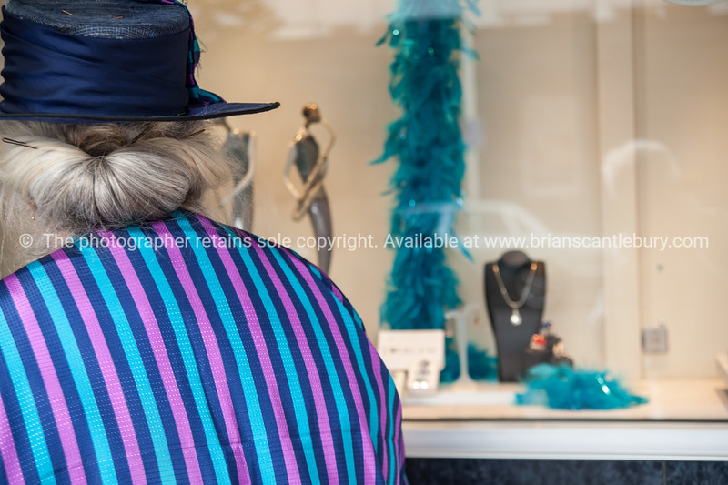 """Jazz Festival, Lady in period dress looking in jewellery shop window.<br /> Model released; no. Editorial and personal use only See;  <a href=""""http://www.blurb.com/b/3811392-tauranga"""">http://www.blurb.com/b/3811392-tauranga</a> mount maunganui landscape photography, Tauranga Photos; Tauranga photos, Photos of Tauranga Also see; <a href=""""http://www.brianscantlebury.com/Events"""">http://www.brianscantlebury.com/Events</a>"""
