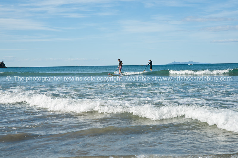"""Paddle-boarding at Mount Maunganui.<br /> Model Release; no. See;  <a href=""""http://www.blurb.com/b/3811392-tauranga"""">http://www.blurb.com/b/3811392-tauranga</a> mount maunganui landscape photography, Tauranga Photos; Tauranga photos, Photos of Tauranga Also see; <a href=""""http://www.brianscantlebury.com/Events"""">http://www.brianscantlebury.com/Events</a>"""