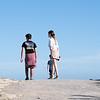 Three siblings walking on summit Mount Maunganui.