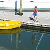 Small boy of marina pier fishing