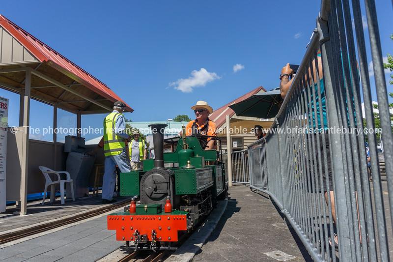 Model railway enthusiast engineers prepare vintage miniature train to offer rides.