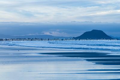 Blue day, Mount Maunganui from Papamoa beach.