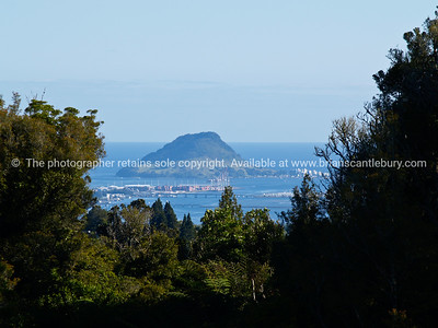 Tauranga scenics.  Mount Maunganui, viewed from the rural area with city and harbour. Tauranga is New Zealands 5th largest city and offers a wonderfull variety of scenic and cultural experiences. Tauranga stock images Tauranga scenics. See; www.blurb.com/b/3811392-tauranga mount maunganui landscape photography, Tauranga Photos; Tauranga photos, Photos of Tauranga Also see; http://www.brianscantlebury.com/Events