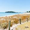 Mount Ocean beach on warm summer day, jandals left on grass.