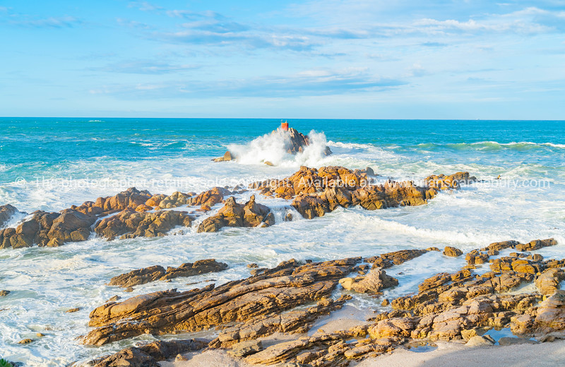 Storm waves crashing into rocky foreshore