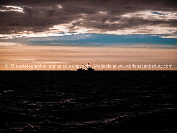 Fishing boat ZMA 2925 on horizon.