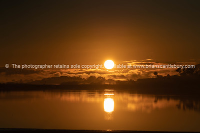 Golden glow of sunrise