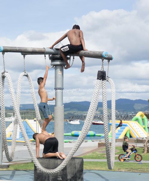 three Maori boys climbing on play equipment on Tauranga waterfront playground.
