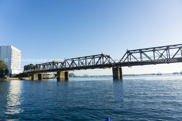 Railway bridge crossing from downtown Tauranga to Matapihi across Tauranga harbour