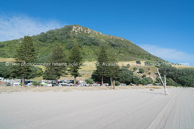 Sand grooming patterns on Mount Main Beach in front of Mount Camp and under landmark mountain,
