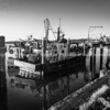 Tauranga waterfront, old wharf with moored fishing boat