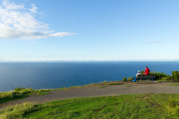 Couple sitting near summit Mount Maunganui, taking a break and looking at the sea view. Tauranga, Mount Maunganui photos