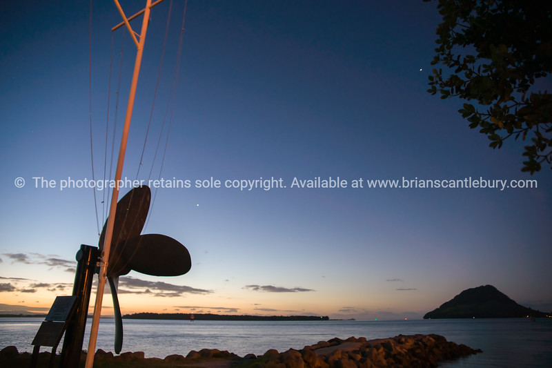 Mount Maunganui on horizon, large bronze propeller from historic tug boat, Taioma.