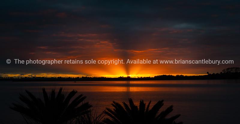 Brilliant sunrise through cloudy sky