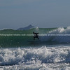 """Surfer carving across a wave on Mount Maungaui's oceanbeach. Mayor Island on the horizon. Tauranga is New Zealands 5th largest city and offers a wonderfull variety of scenic and cultural experiences. Tauranga stock images Tauranga scenics. See;  <a href=""""http://www.blurb.com/b/3811392-tauranga"""">http://www.blurb.com/b/3811392-tauranga</a> mount maunganui landscape photography, Tauranga Photos; Tauranga photos, Photos of Tauranga Also see; <a href=""""http://www.brianscantlebury.com/Events"""">http://www.brianscantlebury.com/Events</a>"""