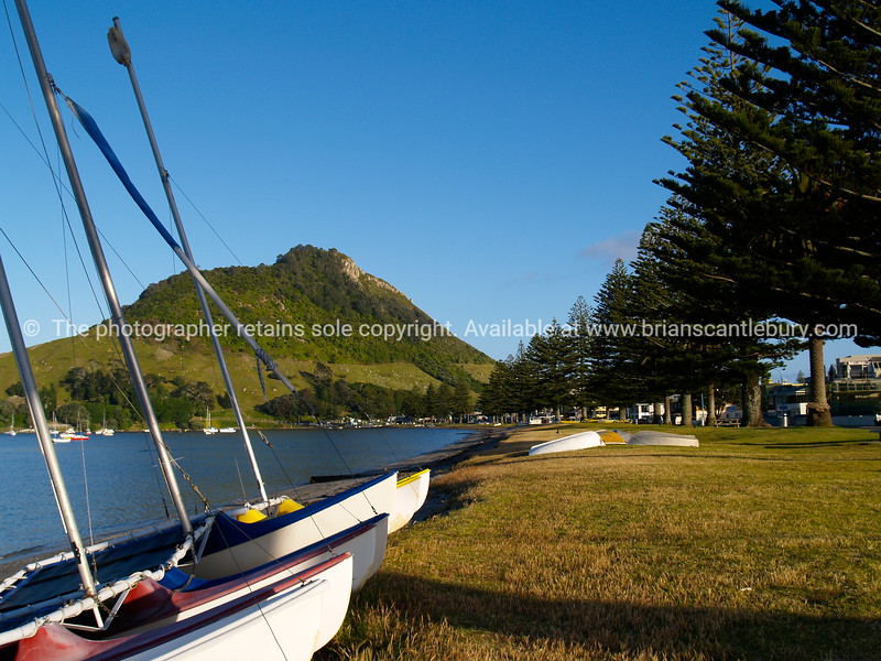 "Tauranga scenics.<br /> <br /> Mount Maunganui, harbour side view. Tauranga is New Zealands 5th largest city and offers a wonderfull variety of scenic and cultural experiences. Tauranga stock images Tauranga scenics. See;  <a href=""http://www.blurb.com/b/3811392-tauranga"">http://www.blurb.com/b/3811392-tauranga</a> mount maunganui landscape photography, Tauranga Photos; Tauranga photos, Photos of Tauranga Also see; <a href=""http://www.brianscantlebury.com/Events"">http://www.brianscantlebury.com/Events</a>"