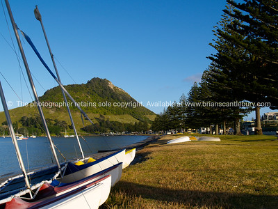 Tauranga scenics.  Mount Maunganui, harbour side view. Tauranga is New Zealands 5th largest city and offers a wonderfull variety of scenic and cultural experiences. Tauranga stock images Tauranga scenics. See; www.blurb.com/b/3811392-tauranga mount maunganui landscape photography, Tauranga Photos; Tauranga photos, Photos of Tauranga Also see; http://www.brianscantlebury.com/Events
