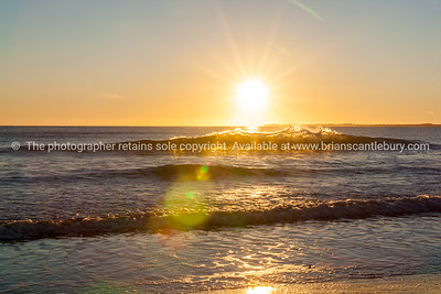 Papamoa Beach, outlok to horizon beautiful glow into into sunrise