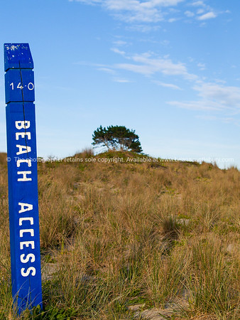 "Beach scene, ""Beach Access"" sign on Papamoa Beach, Bay of Plenty, New Zealand."