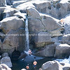 Scenic waterfalls at with people