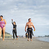 Contestants and spectators for the Gneeration Homes Sand to Surf swim event on overcast day.