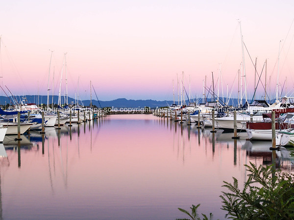 Marina at sunrise. Calm water and colourful sky.